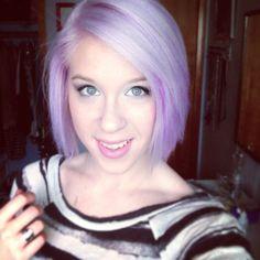 Med length pastel purple hair.