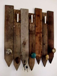DIY coat rack using old door knobs and fencing.