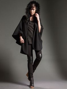 Model wears Naughty Dog FW15 cashmere cape with eco fur hood and a pair of skinny pants with eco leather inserts.