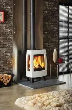 The Dovre Sense 113 wood burning stove has the signature ultra-contemporary styl… – Freestanding fireplace wood burning Stove Fireplace, Fireplace Design, Wood Burning Logs, Wood Burning Stoves, Black Brick Wall, Salons Cosy, Multi Fuel Stove, Freestanding Fireplace, Wood Burner