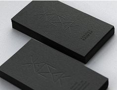 Black blind embossed business card - you have to be very cool to have these. Tom Ford and maybe Frank Gehry.