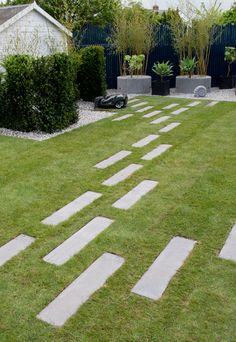 Set paving into the lawn as stepping stones - set it low so you can mow over it
