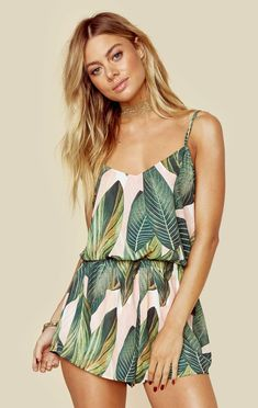 """Show Me Your Mumu's Rorey Romper features an allover palm print, cinched waist, and flounce shorts. Adjustable straps.   Made in USADry Clean Only100% PolyFit Guide:Model is 5ft 7 inches; Bust: 34"""", Waist: 25"""", Hips: 35""""Model is wearing a size XSRelaxed FitShoes Featured Not Available For Purchase"""