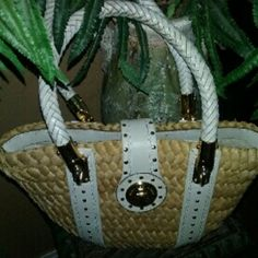 Micheal kors straw handbag A straw trim with white leather handbag that measure about 9 ins from top to bottom and about 14 ins from side to side and strap drop about 8 ins the strap has some sign of soil and wear no rips or tears in good used condition and inside has some small sign of soil no rips or tears in good used condition. Michael Kors Bags Totes