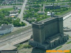 Massive abandoned train station in Detroit. Even at the height of rail in the 1930s, when this building was completed, the top four floors were never occupied.  Now the entire building is abandoned, which is too bad because it is so grand and elegant...but Detroit is a lost city of many beautiful abandoned buildings.