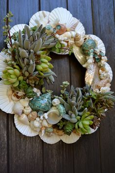 Succulent wreath with authentic sea shells.  Just the thing to add easy style and drama to a summer door.