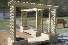 Step by step DIY instructions for how to build a trellis planter bench that you can add to your playground or other play space.