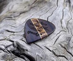 No stock photos here! The guitar pick shown is the actual pick you will receive, both sides are shown, (both sides are engraved), a different design is laser engraved on each side, see photos. Made with Yucatan ziricote, Hawaiian koa, & hard maple, 3 very beautiful, dense & durable exotic, & domestic hardwoods. This premium guitar pick was meticulously handcrafted independently, it features a concave thumb groove on each side to ensure a firm grip, & also give the pick an incr...