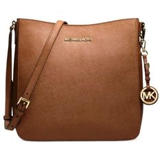 Michael kors crossbody  bag Only used for less than a month! in great condition. Only issue is there is a small black stain on the back opening, everything else is in perfect condition! Comes with dust bag! MICHAEL Michael Kors Bags Satchels