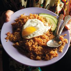 Indonesian Fried Rice (Nasi Goreng). A simple breakfast dish, not at all like the too-much-of-a-good-thing fried rice so common in the United States, with its confetti of chopped ham and peas. For nasi goreng, leftover rice is stir-fried with a seasoning paste made from chiles, shrimp paste, and palm sugar, yielding a richly flavored dish that's ridiculously delicious. With a fried egg on top, it becomes a meal.