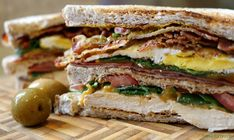 Worlds best sandwich piled high with grilled chicken chorizo ham fried egg bacon cheese tomato rocket on a toasted wheat bread. Wrap Recipes, Pork Recipes, Healthy Recipes, Eat Healthy, Grilled Ham, Grilled Chicken, Dagwood Sandwich, Chicken Chorizo, Chicken Ham