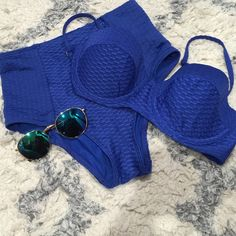 Blue 2-piece bathing suit Super cute high waisted 2 piece suit! Used once. Straps from the top are removable TOP IS A MEDIUM AND BOTTOMS ARE A SMALL  Forever 21 Swim Bikinis