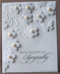 emboss part; diecut and pop-up flowers, add pearls, butterfly and sentiment