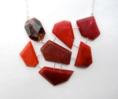 A personal favorite from my Etsy shop https://www.etsy.com/listing/211804877/red-statement-necklace-geometric