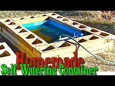 Homemade Self Watering Container Gardening Construction using a Rain Barrel - YouTube.  Interesting self-watering raised beds in a desert situation.