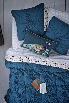Love these bedding vignettes from Anthro, plus all the new colors of the Rosette Quilt #AnthroFave