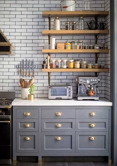 Grey cabinets with brass pulls