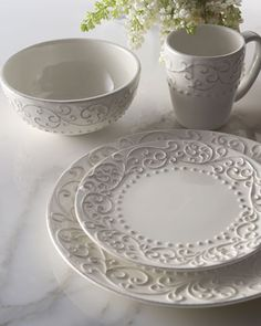 """Scroll"" 16-Piece Dinnerware - A pattern of raised scrolls and dots make this gorgeous antique-white dinnerware stand out in any table setting.  Made of ceramic.  Dishwasher safe.  Set includes four dinner plates, salad plates, cereal bowls, and mugs.  Imported. $80"
