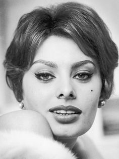 April 1959:  Closeup of Italian actor Sophia Loren with bare shoulders and a…