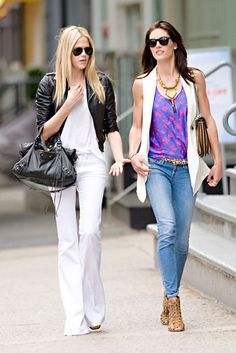 Byrdie Bell toughens up her white flares with a motorcycle jacket, while Hilary Rhoda puts a feminine spin on her light-wash jeans with a floral tank and leopard belt.