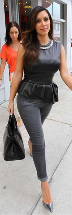 Kim Kardashian: Shoes – Jimmy Choo  Shirt – Christian Dior  Purse – Hermes  Jeans – Blue Lab