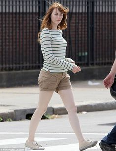 Summer style: The 25-year-old showed off her legs in khaki shorts paired with a long-sleeved striped top   Read more: http://www.dailymail.co.uk/tvshowbiz/article-2693402/Emma-Stone-spotted-time-set-star-Joaquin-Phoenix-begin-shooting-new-Woody-Allen-film-Rhode-Island.html#ixzz37JVzgBv6  Follow us: @MailOnline on Twitter | DailyMail on Facebook