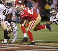 The 49ers number 21 Frank Gore busting into the end zone for a touchdown.