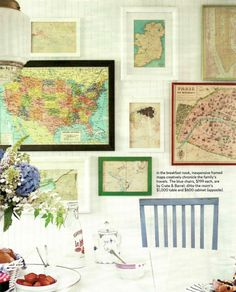 Gallery wall with vintage maps.