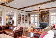 Rolling Library Ladder Living Room Victorian with Area Rug Distressed Leather Sofa Exposed Beams Exposed Stone