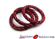 A Handcrafted set of 3 bangles/bracelets wrapped with strips of  Red Shweshwe African Print Fabric. The round bangles are super lightweight and come in an assortment of Blue, Green, Yellow, Purple, Red, and Brown Colours.  All our round bangles come in 2 sizes: Small (63mm) for the slightly smaller wrist and Medium (75mm) for those who still prefer the standard bangle sizes. Each colour of Shweshwe African Print Fabric accessories include: Small Stud Earrings