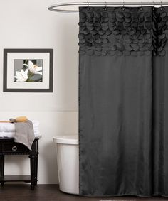 Shower in style with this classy curtain. Showcasing a 3-D effect created by hand-stitched, laser-cut circles, this sophisticated accent can easily be installed for an instant bathroom makeover.