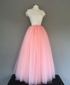 Floor length tulle skirt- available in many colors  Made with 4 layers of tulle solid pieced and fully sewn, no strips or knots. TAKING MEASUREMENTS: