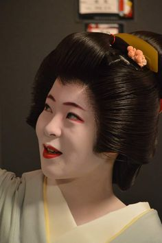 February 2017: Fresh Geiko Katsuhina (Odamoto Okiya) of Gion Kobu at a photography-exhibition.  Source: Akihito Miyaji on Facebook