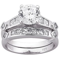 Stil inexpensive...only $60 at walmart for a Sterling Silver 6.6 Carat T.G.W. Cubic Zirconia 2 piece Wedding Ring Set