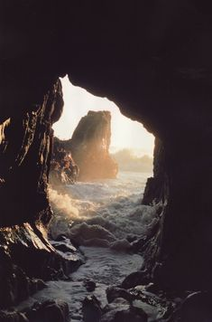 What a lovely invitation to move through the mysterious rocks out into the open sea bathed in sunlight...