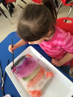 Painting on blocks of ice with watercolours! The kids love it! Use a large rectangle margarine container to freeze ice about 1.5 inches thick. Put on a dollar store serving tray for easy cleanup. I used a dish cloth in between to keep ice from sliding around.  Rinse off with warm water and re-paint!