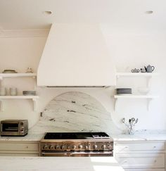 Scout for the Home - kitchens - white kitchen cabinets, neutral kitchen, white marble counters, white marble countertops, arched stove backs. Kitchen Hoods, Kitchen Stove, White Kitchen Cabinets, Kitchen White, Upper Cabinets, Inset Cabinets, Kitchen Dining, Dining Room, Kitchen Shelves