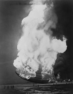 Hindenburg Hits The Ground by Everett The Hindenburg hits the ground in flames in Lakehurst, N. on May Hindenburg hits the ground in flames in Lakehurst, N. Zeppelin, Mysteries Of The World, Alternate History, World History, Historical Photos, Vintage Images, Old Photos, Air Ship, Aircraft
