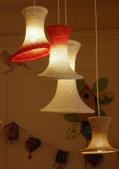 A cascade of knitted and dip dyed lampshades by Helen Taylor of Ose design.