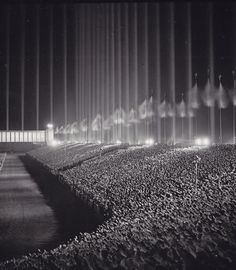 """Nazi Rally being held at the """"Cathedral of Light"""" in Nuremberg. Designed by Albert Speer, the """"cathedral"""" actually consisted of 152 anti-aircraft searchlights, at intervals of 12 metres, aimed skyward to create a series of vertical bars surrounding th. World History, World War Ii, Ww2 History, Asian History, Tudor History, History Photos, British History, History Facts, Nuremberg Rally"""
