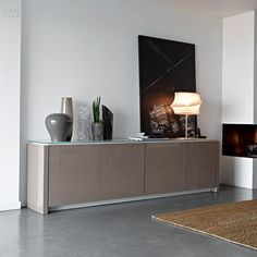 A Lovely and Modern Sideboard for a Contemporary Living Room | www.bocadolobo.com #bocadolobo #luxuryfurniture #exclusivedesign #interiodesign #designideas #sideboardideas #originalsideboards #creativesideboardesigns