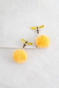 Bee More Happy Pom Earrings $14