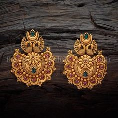 Designer antique earrings studded with synthetic ruby green stones, plated with gold polish, made of copper alloy Gold Jhumka Earrings, Indian Jewelry Earrings, Jewelry Design Earrings, Gold Earrings Designs, Gold Jewellery Design, Necklace Designs, Gold Jewelry, Stud Earrings, Jewellery Box