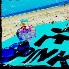 big sun glasses, the best tanning lotion, water and sand <3