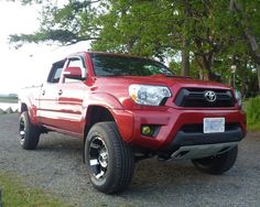 """Great looking Barcelona Red 2012 Toyota Tacoma with a 3"""" lift."""