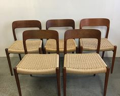 Set of 6 Beautiful Danish dining chairs made by Moller of Denmark. Newly woven seats ensure use for the next 30 years.We have 4 teak chairs and 2 oak chairs in stock.