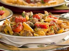 One Pot Italian Feast - A hearty dinner that includes ingredients like Italian sausage, onion, celery, pasta, tomatoes, and more!