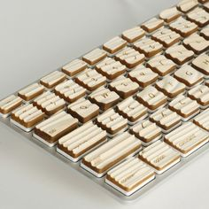 Apple modified keyboard with wooden ridges.