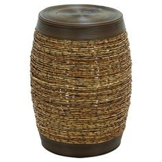 Evoking a traditional drum, this wood stool is wrapped in rattan for a natural touch. Nestle it between two chairs as a chic side table, or place it in your ...