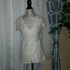 White lace see through top White lace see through top. In perfect condition! Can put a white tank under for coverage :) 75%cotton 25%nylon Tops Tees - Short Sleeve